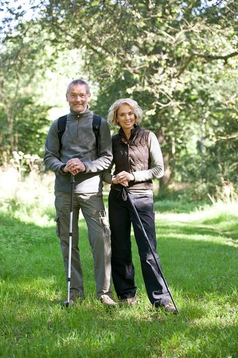 Stock Photo: 1804R-21231 A mature couple standing in the countryside together