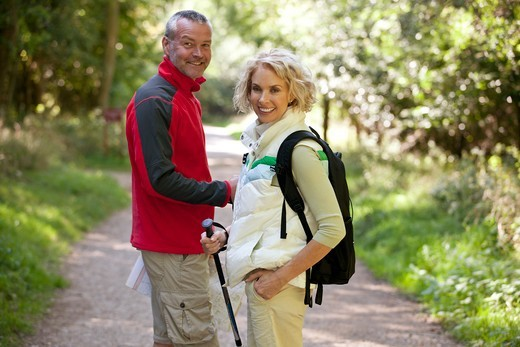 Stock Photo: 1804R-21257 A mature couple standing on a country path smiling, close up