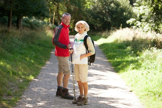 Stock Photo: 1804R-21258 A mature couple standing on a country path, smiling