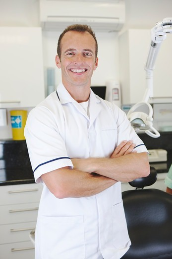 Stock Photo: 1804R-21276 A male dentist in a dental surgery
