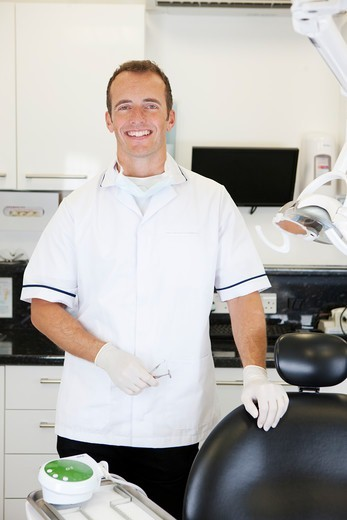 Stock Photo: 1804R-21277 A male dentist in a dental surgery