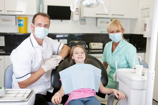 Stock Photo: 1804R-21278 A dentist and dental nurse with a young girl patient
