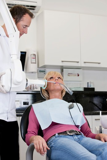 Stock Photo: 1804R-21310 A female patient having an x-ray at the dentist