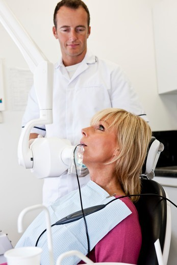 Stock Photo: 1804R-21311 A female patient having an x-ray at the dentist