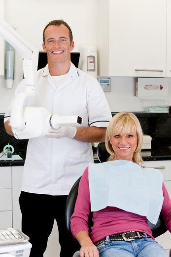 Stock Photo: 1804R-21313 A male dentist with a female patient in his surgery