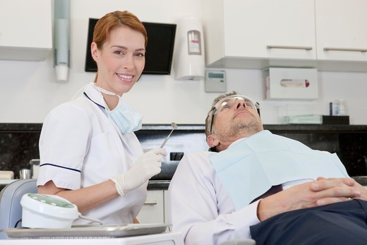Stock Photo: 1804R-21319 A female dentist with a male patient