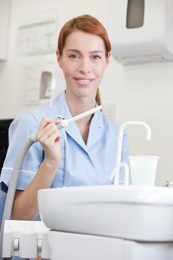 Stock Photo: 1804R-21331 A portrait of a female dental nurse/hygienist