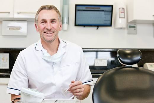 Stock Photo: 1804R-21332 A male dentist in a dental surgery