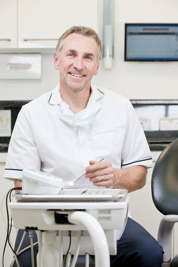 Stock Photo: 1804R-21333 A male dentist in a dental surgery