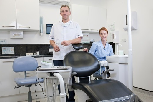 Stock Photo: 1804R-21334 A male dentist and female dental nurse in a dental surgery