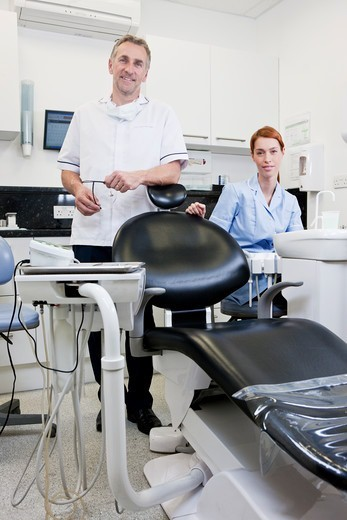 Stock Photo: 1804R-21335 A male dentist and female dental nurse in a dental surgery