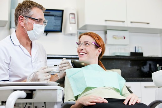 Stock Photo: 1804R-21343 A male dentist talking to a female patient