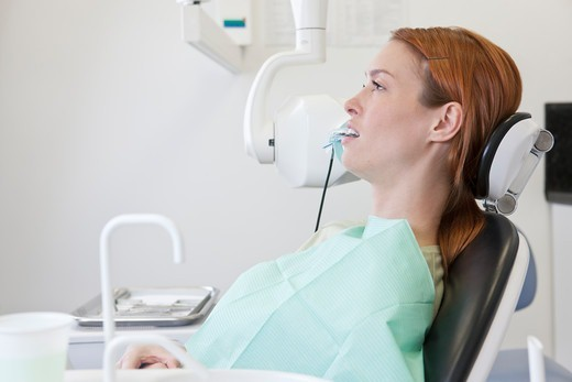 Stock Photo: 1804R-21352 A female patient having an x-ray at the dentist