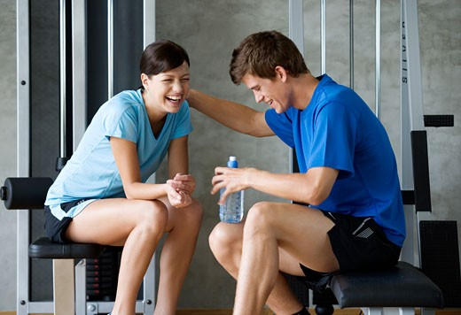 Two friends sitting in a gym : Stock Photo
