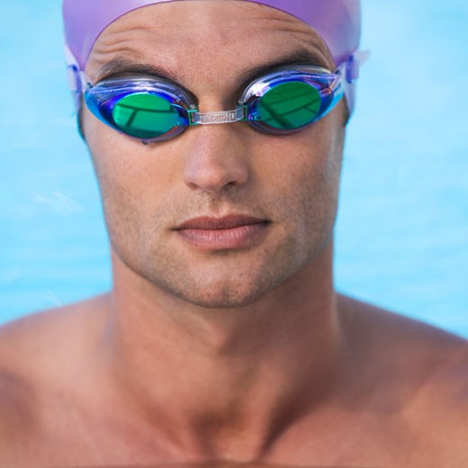 A young man in a swimming pool : Stock Photo