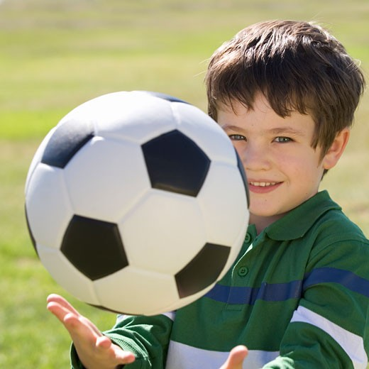 Stock Photo: 1804R-3530 A young boy with a football