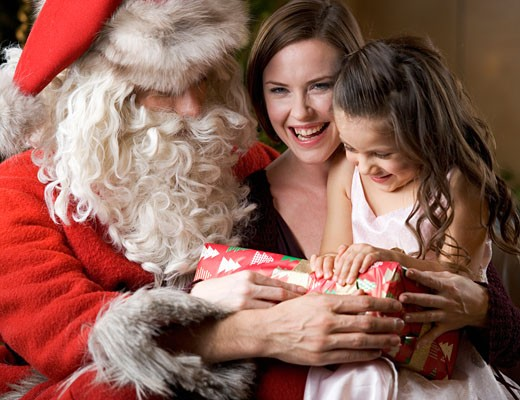 Father christmas / santa Claus with a mother and daughter : Stock Photo