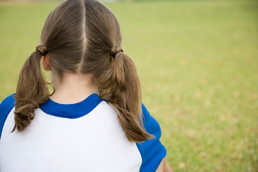 Rear view girl sitting on the grass : Stock Photo