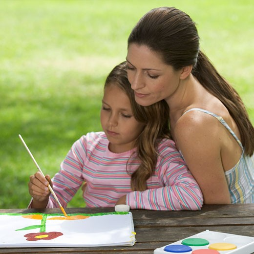 Stock Photo: 1804R-6488 Mother and young daughter sitting in a garden painting