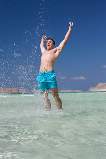 A man standing in the sea : Stock Photo