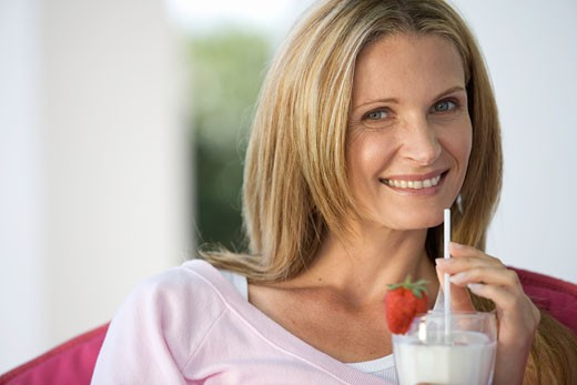 A woman drinking a health drink : Stock Photo