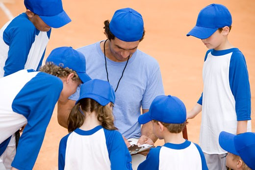 Youth league baseball team and coach on pitch : Stock Photo