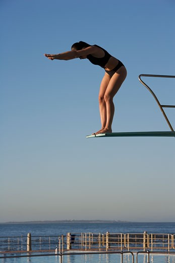A woman diving into a pool : Stock Photo