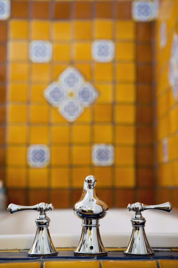 Bathroom Faucet in Brightly Tiled Bathroom : Stock Photo