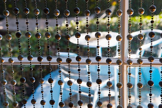 Bead Curtains in Front of Window : Stock Photo