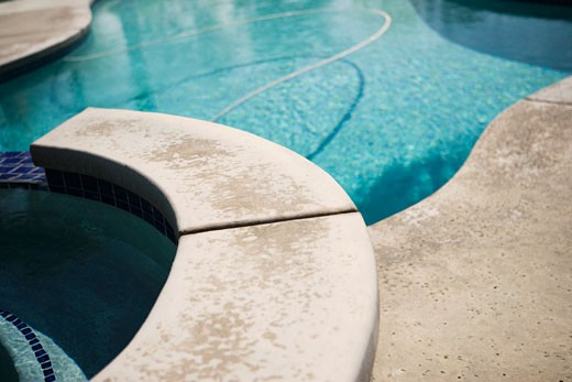 Detail of Stonework on Backyard Swimming Pool : Stock Photo