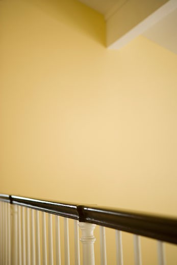 Wooden Bannister Railing and Yellow Walls : Stock Photo