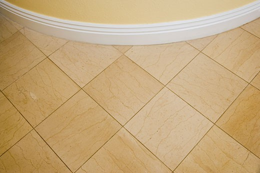 Detail of Curved Wall and Tile Floor : Stock Photo