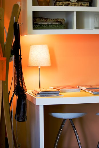 Work Desk with Orange Walls : Stock Photo