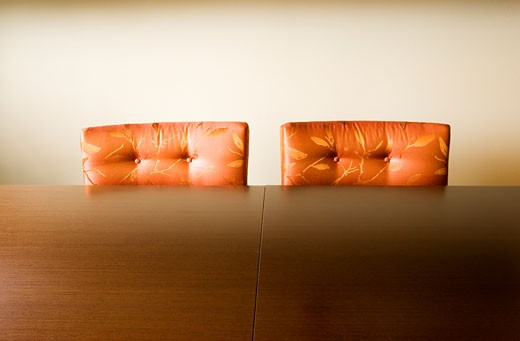 Two Cushioned Orange Dining Chairs : Stock Photo