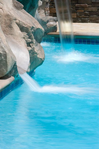 Rock Waterfall to Swimming Pool : Stock Photo