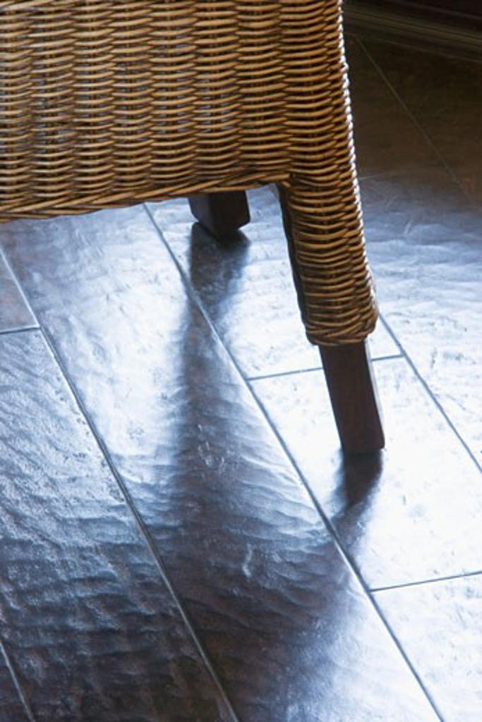 Wicker Chair on Hardwood Floor : Stock Photo
