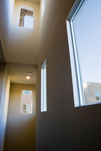 Stock Photo: 1806R-3896 Dark Stairwell with High Ceilings and Windows