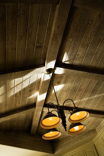 Stock Photo: 1806R-4464 Light Fixture and Vaulted Wood Beam Ceiling