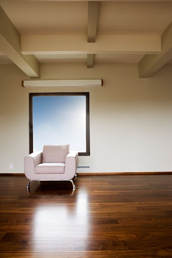 Modern Leather Armchair Under Window : Stock Photo