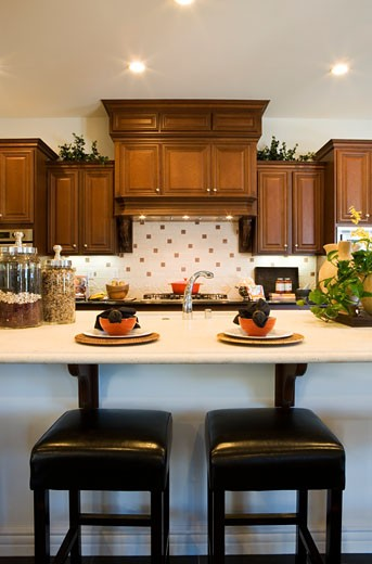 Vignette of kitchen with two barstools. : Stock Photo