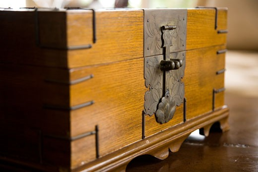 Detail of decorative metal latch on wooden chest. : Stock Photo