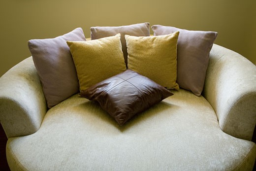 Circular sofa bed with throw pillows : Stock Photo