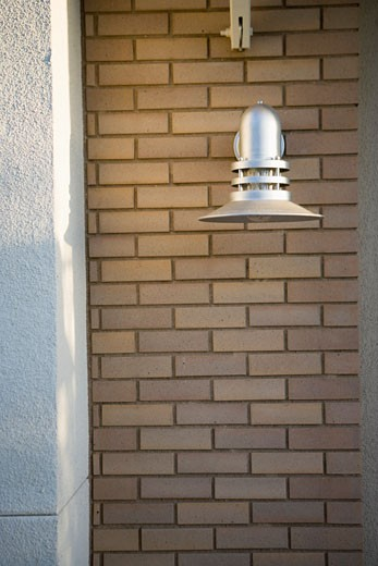 Stock Photo: 1806R-7653 industrial style exterior wall light on brick wall