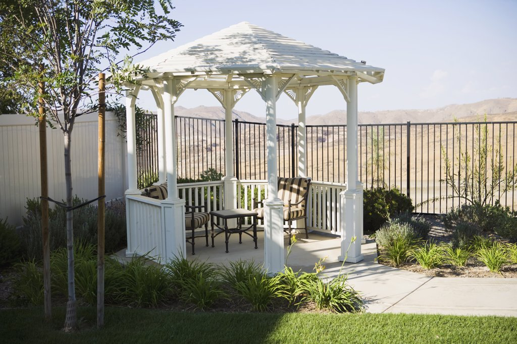 Small backyard gazebo with patio furniture : Stock Photo