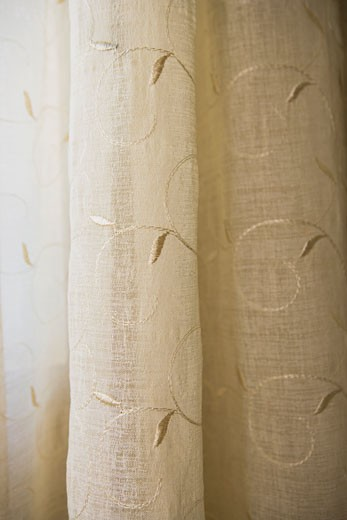 Detail cream colored sheer curtains : Stock Photo