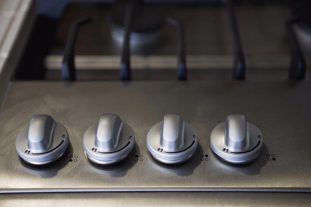 Detail knobs on stove top : Stock Photo