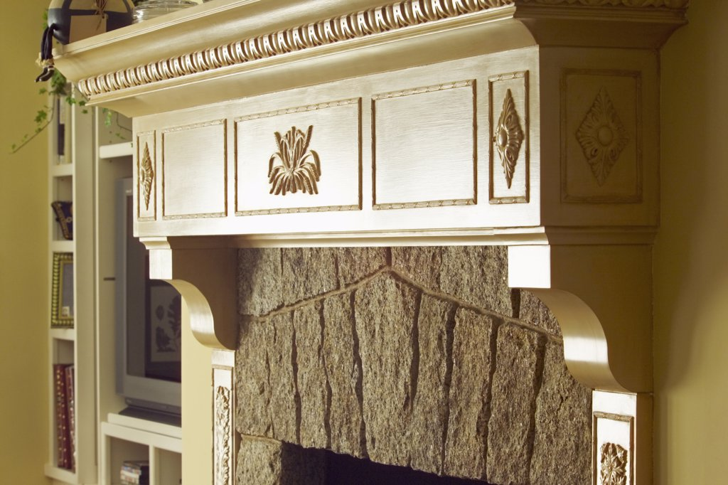 Close up traditional fireplace mantle : Stock Photo