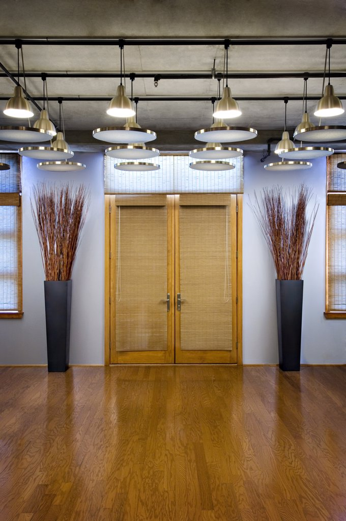 Stock Photo: 1806R-8461 Symmetrical double doors with wood floors and ceiling lights