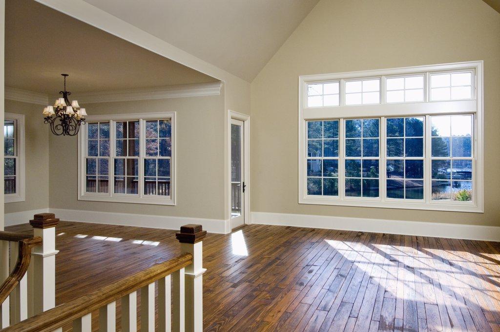 Stock Photo: 1806R-8500 Empty great room with hardwood floors