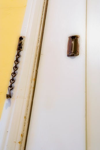 Detail door with safety chain lock : Stock Photo